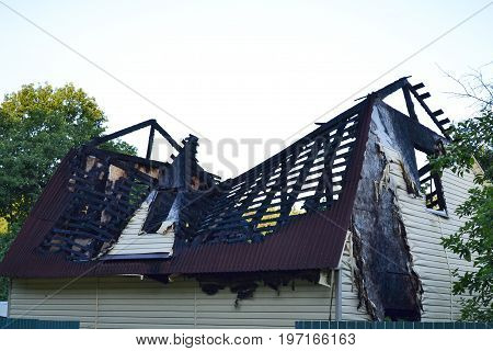 Damage to the roof from the fire. The house completed by Siding suffered from a fire. Fire safety