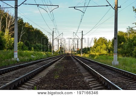 Two electrified railway tracks stretching into the distance