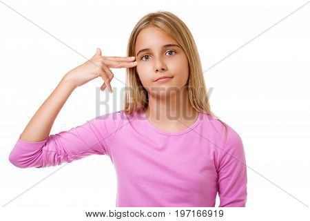 Young teen girl shoots herself in the head with finger gun gesture.White background