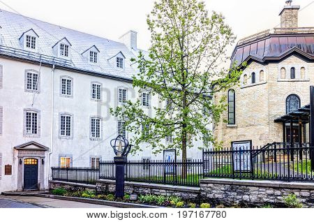 Quebec City, Canada - May 31, 2017: View Of Seminary With Sidewalk And Notre Dame Church