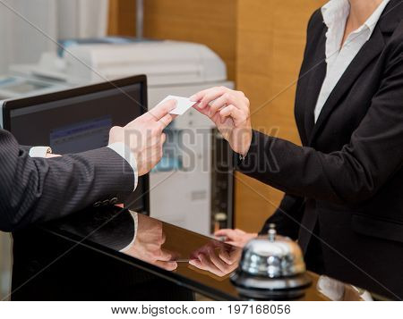 Businessman is arrived in hotel and is checking-in