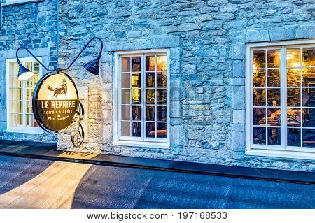 Quebec City, Canada - May 31, 2017: Le Repaire Restaurant Sign Closeup During Blue Hour By Lower Old