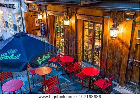 Quebec City, Canada - May 31, 2017: Restaurant With Grolsch Sign And Red Chairs Outside During Blue