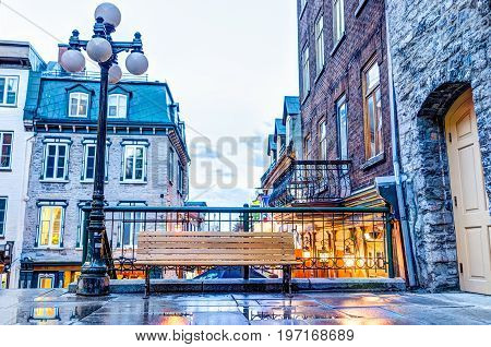 Quebec City, Canada - May 31, 2017: Empty Bench During Blue Hour By Lower Old Town Street Called Rue