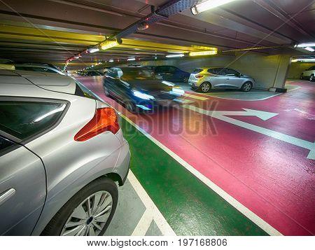 underground parking garage with a moving car