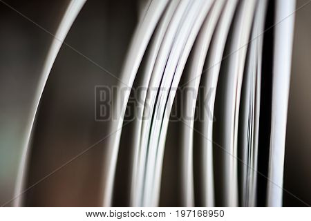 A beautiful closeup of a book in dark red cover and with red bookmark. Shallow depth of field