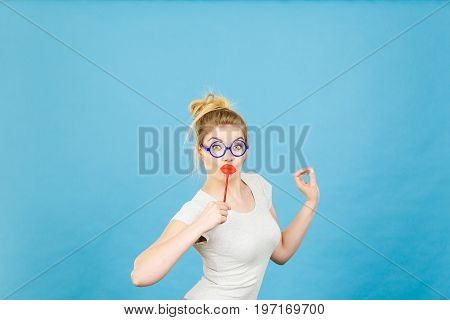 Happy Woman Holding Fake Lips On Stick