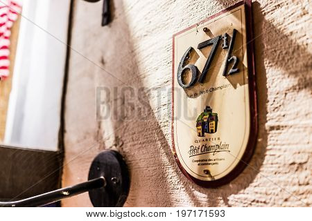 Quebec City, Canada - May 31, 2017: Lower Old Town Street Rue Du Petit Champlain With Closeup Of Sig