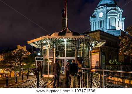 Quebec City, Canada - May 31, 2017: Old Town View Of People On Dufferin Terrace At Night With Illumi