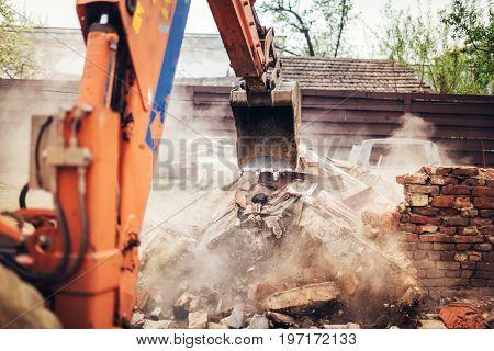 Details Of Backhoe Excavator Scoop Demolishing Ruins, Destroying And Loading Debris