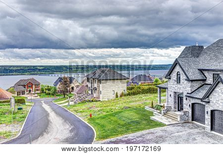 Boischatel, Canada - June 1, 2017: Residential Single Family Houses Overlooking Saint Lawrence River