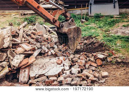 Industrial Backhoe Excavator Using Scoop For Demolishing Ruins