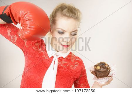 Woman Fighting Off Bad Food, Boxing Chocolate Cake