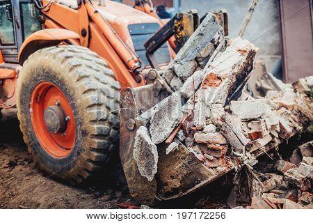 Industrial Backhoe Excavator Using Scoop And Blade For Loading Demolition Debris