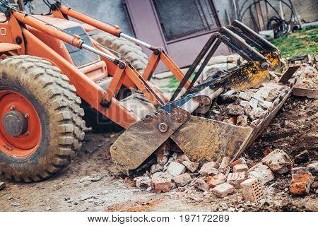 heavy duty Industrial backhoe crusher loading demolition debris poster