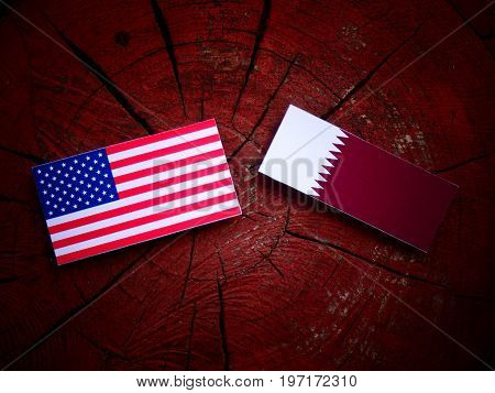 Usa Flag With Qatari Flag On A Tree Stump Isolated