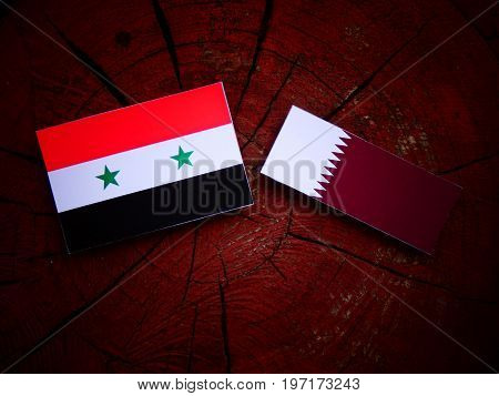 Syrian Flag With Qatari Flag On A Tree Stump Isolated