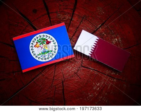 Belize Flag With Qatari Flag On A Tree Stump Isolated