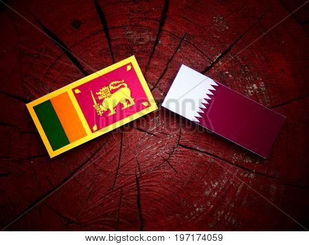 Sri Lankan Flag With Qatari Flag On A Tree Stump Isolated