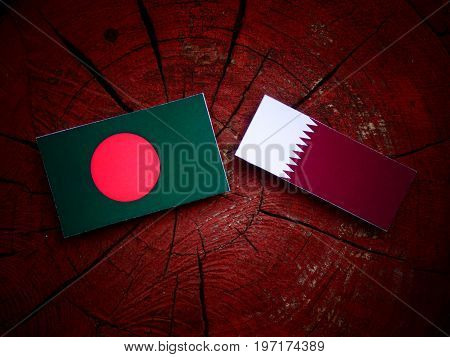 Bangladesh Flag With Qatari Flag On A Tree Stump Isolated