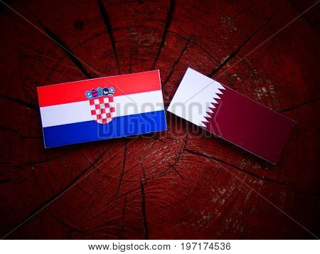Croatian Flag With Qatari Flag On A Tree Stump Isolated