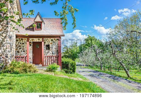Colorful Stone House Cottage Door Entrance With Porch In Village Countryside