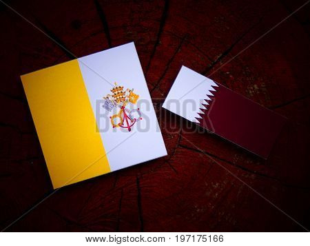 Vatican Flag With Qatari Flag On A Tree Stump Isolated