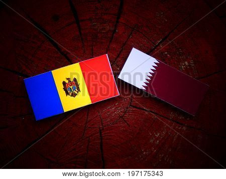 Moldovan Flag With Qatari Flag On A Tree Stump Isolated