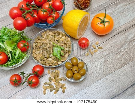 Fresh vegetables and other food on a wooden background. Horizontal photo.
