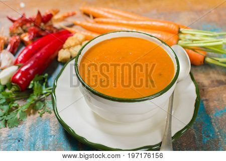 Spicy Carrot Soup With Harissa Made From Hot Chili Pepper, Lemon, Garlic, Coriander.