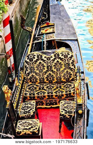Detail of a blue and gold gondola seat from Venice, Italy.