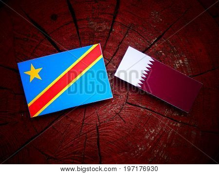Democratic Republic Of The Congo Flag With Qatari Flag On A Tree Stump Isolated