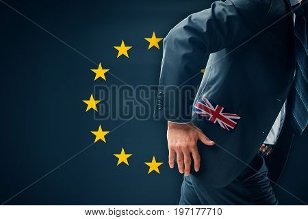 Brexit concept. Businessman (financier, bank employee, CEO, manager) run away (escape) from EU.