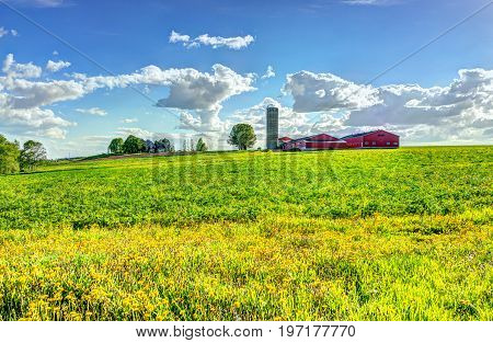 Landscape View Of Farm In Ile D'orleans, Quebec, Canada With Red Building