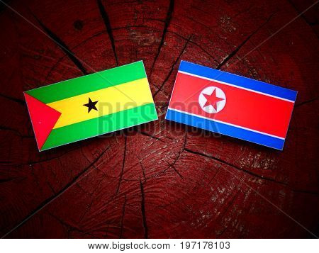 Sao Tome And Principe Flag With North Korean Flag On A Tree Stump Isolated