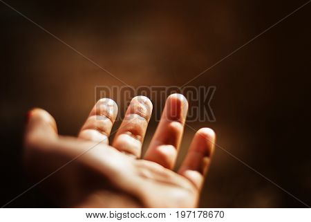 Close-up of hand on a sunset. Empty hand is outstretched with blurred nature background