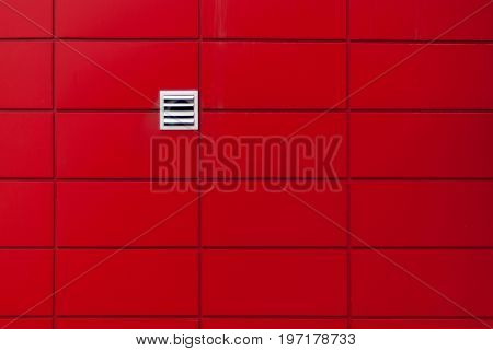 red wall. minimalism concept. with white air vent hole