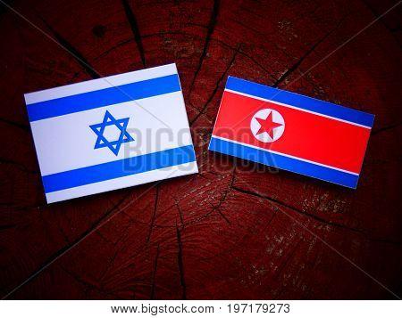 Israeli Flag With North Korean Flag On A Tree Stump Isolated