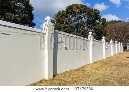 Boundary eight foot wall electrified fence for security.