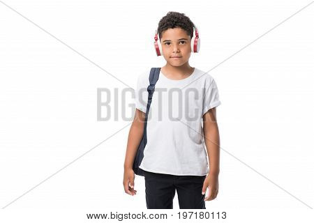 Cute African American Schoolboy Listening Music In Headphones Isolated On White