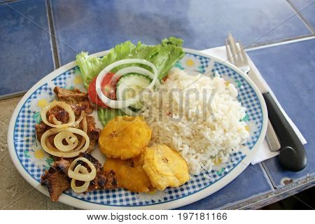 Typical latin american dish with Patacon bananas, Costa Rica, Central America