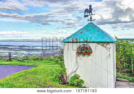 Blue Green Turquoise Painted Shed House With Rooster Compass On Top In Summer Landscape French Count