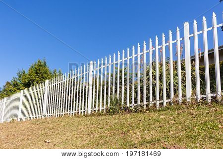 Fence palisade steel white boundary property structure.
