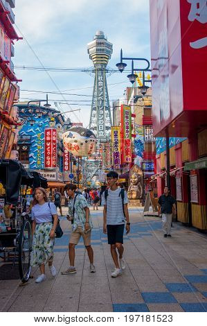 OSAKA, JAPAN - JULY 18, 2017: Tsutenkaku Tower is a tower and well-known landmark of Osaka. It is located in the Shinsekai district of Naniwa-ku, Osaka, Japan.