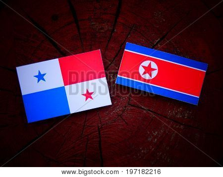 Panamanian Flag With North Korean Flag On A Tree Stump Isolated