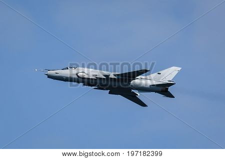 ATTACK AIRCRAFT - A combat aircraft in the blue sky