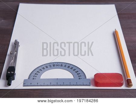 Empty Sheet Of Paper On A Desk With Pencil