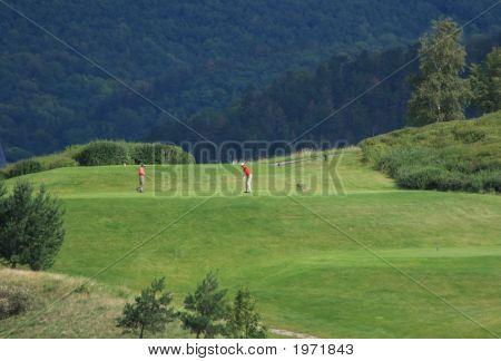 Golfers On Tee