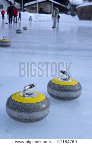 curling stones on an ice ring in sils