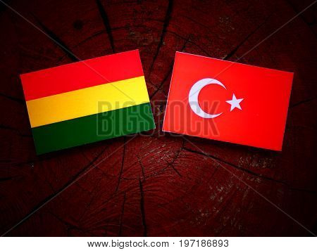 Bolivian Flag With Turkish Flag On A Tree Stump Isolated